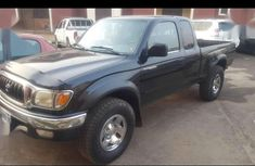 Best priced used black 2003 Toyota Hilux at mileage 10,000
