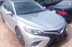Grey 2018 Toyota Camry car at attractive price in Abuja