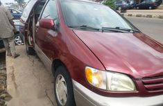 Red 2003 Toyota Sienna van automatic for sale at price ₦1,100,000
