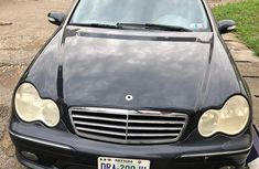Sell very cheap clean black 2006 Mercedes-Benz C230 in Lagos