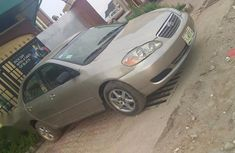 Need to sell used gold 2006 Toyota Corolla automatic at cheap price