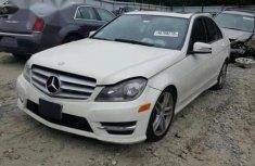 Best priced white 2012 Mercedes-Benz C300 sedan automatic in Lagos