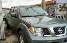 Used grey/silver 2010 Nissan Frontier car automatic at attractive price