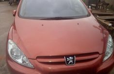 Sell well kept orange 2005 Peugeot 307 sedan at price ₦1,400,000
