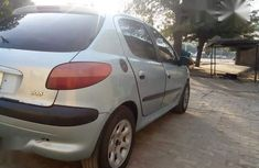 Sell well kept blue 2004 Peugeot 206 manual at price ₦700,000