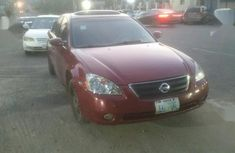Clean and neat red 2003 Nissan Altima for sale