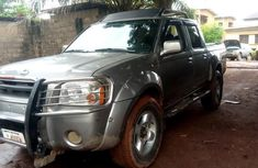 Best priced used gold 2002 Nissan Frontier automatic in Enugu