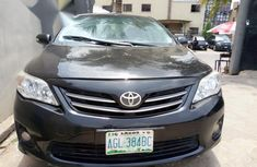 Sell grey/silver 2012 Toyota Corolla at mileage 87,000 in Ikeja at cheap price