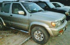 Gold 1999 Nissan Pathfinder car automatic at attractive price in Lagos