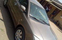 Clean used gold 2006 Toyota Avensis sedan manual for sale in Lagos