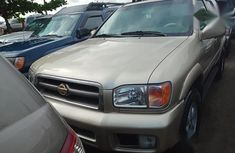 Need to sell gold 2001 Nissan Pathfinder at price ₦1,800,000 in Lagos