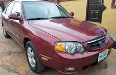 Clean red 2004 Kia Spectra automatic for sale at price ₦500,000