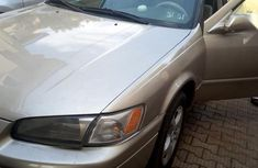 Gold 1999 Toyota Camry automatic at mileage 24,532 for sale