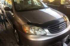 Sell cheap gold 2003 Toyota Corolla at mileage 102