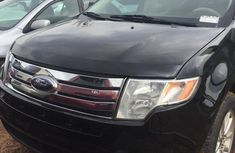 Neatly used black 2010 Ford Edge automatic in Lagos