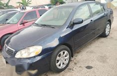 Selling blue 2006 Toyota Corolla sedan in good condition