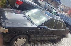 Black 2000 Toyota Corolla sedan automatic for sale at price ₦550,000
