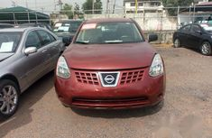 Well maintained red 2009 Nissan Rogue automatic for sale in Ikeja