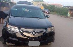 Best priced black 2009 Acura MDX at mileage 107,462 in Lagos