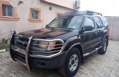 Need to sell cheap used black 2001 Nissan Xterra at mileage 124,781