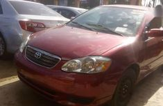 Well maintained red 2003 Toyota Corolla automatic for sale in Ibadan