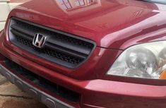 Need to sell high quality red 2005 Honda Pilot automatic at mileage 150,000