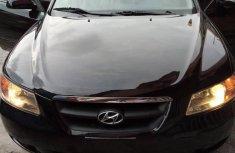 Need to sell cheap used blue 2006 Hyundai Sonata at mileage 50,000