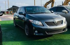 Sell very cheap clean black 2009 Toyota Corolla in Lagos