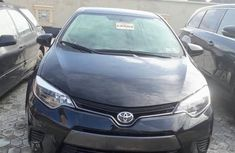 Need to sell high quality black 2015 Toyota Corolla automatic at price ₦4,700,000
