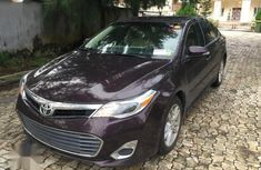 Need to sell red 2016 Toyota Avalon at price ₦8,000,000