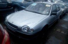 Selling grey/silver 2000 Toyota Corolla manual in Lagos