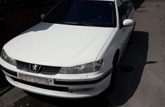 Sell clean used 2004 Peugeot 406 at mileage 182 in Lagos