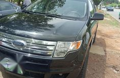 Selling blue 2009 Ford Edge automatic in good condition in Abuja