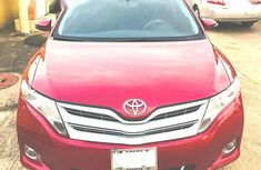 Need to sell high quality red 2014 Toyota Venza at price ₦4,550,000 in Ikeja