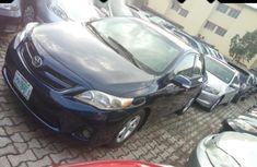 Need to sell high quality blue 2013 Toyota Corolla at price ₦2,600,000 in Lagos