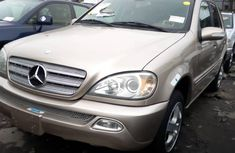 Clean and neat gold 2003 Mercedes-Benz ML 320 for sale