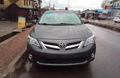 Need to sell cheap used 2012 Toyota Corolla at mileage 80,000 in Lagos
