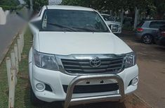 Sparkling white 2012 Toyota Hilux for sale