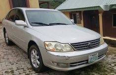 Selling grey/silver 2003 Toyota Avalon automatic at mileage 110,001