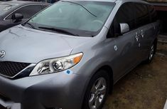 Sell cheap grey 2012 Toyota Sienna van automatic