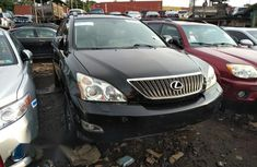 Need to sell cheap used black 2006 Lexus RX at mileage 95,333