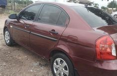 Clean and neat red 2007 Hyundai Accent sedan at price ₦750,000 in Abuja