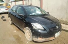 Sell cheap black 2009 Toyota Yaris sedan manual