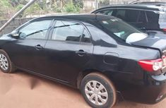 Need to sell cheap 2013 Toyota Corolla sedan at mileage 100,000