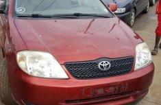 Best priced red 2002 Toyota Corolla sedan manual in Lagos