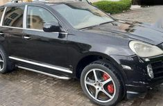 Sell used black 2009 Porsche Cayenne sedan automatic at cheap price