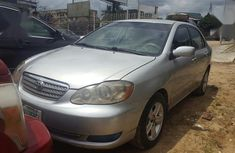 Need to sell grey 2005 Toyota Corolla at mileage 110,000