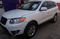 Sell white 2009 Hyundai Santa Fe suv automatic in Lagos