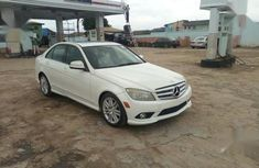 Selling white 2009 Mercedes-Benz C300 sedan in good condition