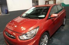 Best priced orange 2014 Hyundai Accent sedan automatic in Lagos